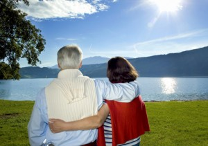 attractive married mature couple enjoying the sunset.